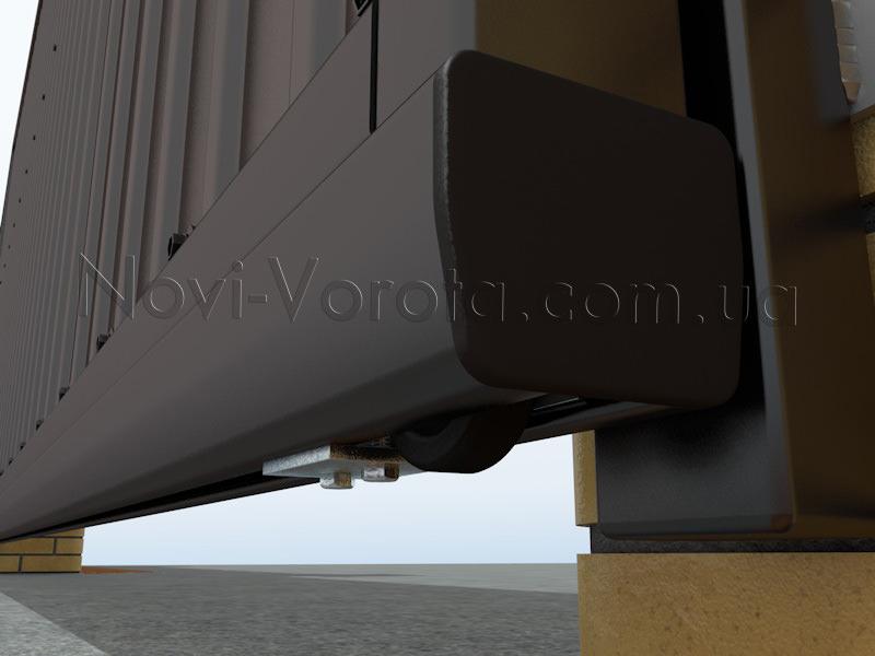 Нижний концевой ролик в направляющем рельсе