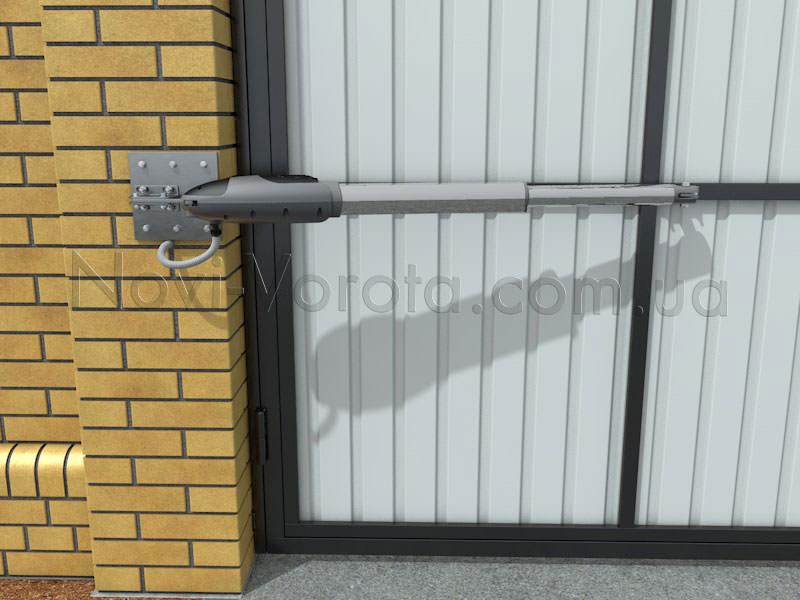Привод, установленный для открывания ворот внутрь