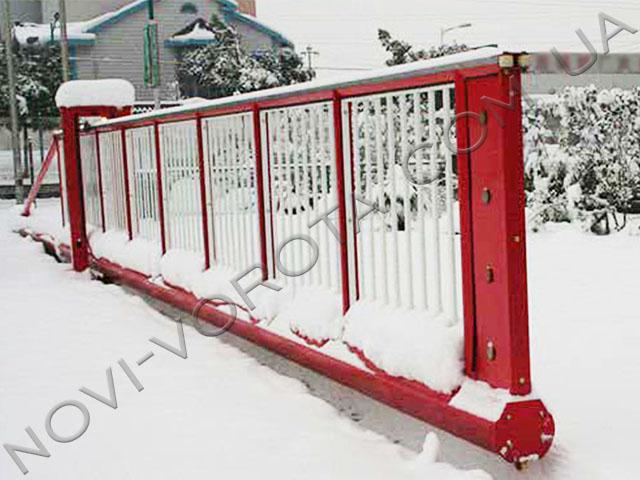откатные ворота в снегу
